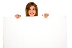 Adolescente con el panel blanco Fotografía de archivo libre de regalías