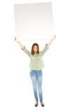 Adolescente con el panel blanco Foto de archivo libre de regalías