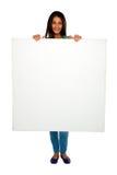 Adolescente con el panel blanco Imágenes de archivo libres de regalías