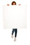 Adolescente con el panel blanco Fotos de archivo libres de regalías
