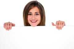Adolescente con el panel blanco Fotografía de archivo