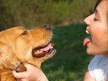 Adolescente con el perro Imagen de archivo