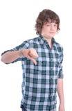 Adolescente con el pulgar abajo Foto de archivo libre de regalías