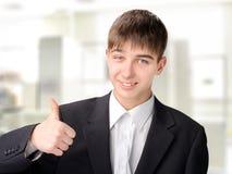Adolescente con el pulgar para arriba Foto de archivo libre de regalías
