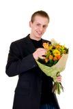 Adolescente con el ramo de flores Imagenes de archivo
