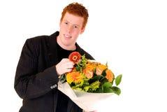 Adolescente con el ramo de flores Fotos de archivo