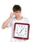 Adolescente con el reloj grande Fotos de archivo