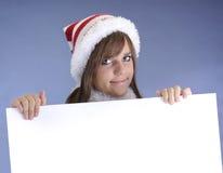 Adolescente con el sombrero de la Navidad Foto de archivo libre de regalías