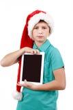 Adolescente con el sombrero de Papá Noel Fotografía de archivo