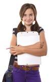 Adolescente con el tablero y el lápiz que sonríe, aislado en pizca Fotos de archivo libres de regalías