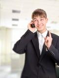 Adolescente con el teléfono Imagen de archivo libre de regalías