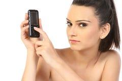 Adolescente con el teléfono celular Foto de archivo libre de regalías