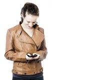 Adolescente con el teléfono celular Fotos de archivo libres de regalías