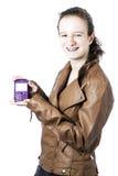 Adolescente con el teléfono celular Imagenes de archivo