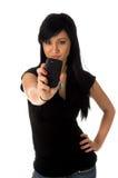 Adolescente con el teléfono de la cámara Imágenes de archivo libres de regalías