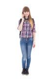 Adolescente con el teléfono móvil aislado en blanco Imágenes de archivo libres de regalías