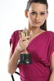 adolescente con el trofeo del oro Imagen de archivo