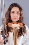 Adolescente con el trombón Imagen de archivo