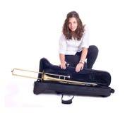 Adolescente con el trombón Foto de archivo