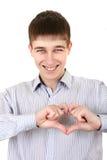 Adolescente con forma del corazón Imagen de archivo