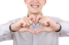Adolescente con forma del corazón Imagenes de archivo
