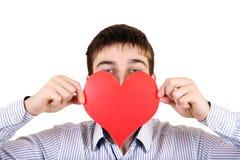 Adolescente con forma roja del corazón Fotos de archivo