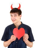 Adolescente con i corni ed il cuore del diavolo Fotografia Stock