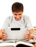 Adolescente con il computer della compressa Immagine Stock