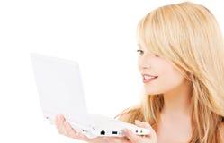 Adolescente con il computer portatile Immagini Stock