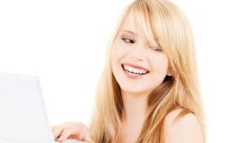 Adolescente con il computer portatile Fotografia Stock