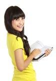 Adolescente con il libro Fotografia Stock