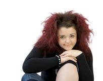 Adolescente con la barbilla en rodilla Fotos de archivo libres de regalías