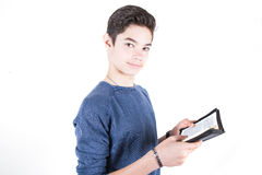 Adolescente con la biblia a disposición Fotografía de archivo libre de regalías