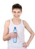 Adolescente con la botella de agua Fotografía de archivo