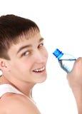 Adolescente con la botella de agua Fotos de archivo libres de regalías