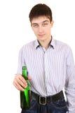 Adolescente con la botella de la cerveza Imagen de archivo