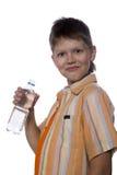 Adolescente con la botella plástica Imagen de archivo