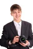Adolescente con la cámara Imagen de archivo