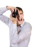 Adolescente con la cámara de la foto Fotografía de archivo