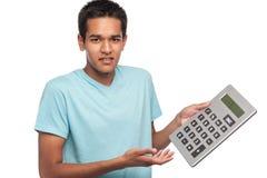 Adolescente con la calculadora grande Fotos de archivo