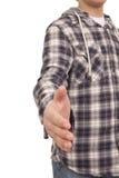 Adolescente con la camisa moderna que gesticula el apretón de manos Imagen de archivo