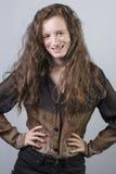 Adolescente con la chaqueta negra y marrón Imágenes de archivo libres de regalías