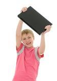 Adolescente con la computadora portátil Imagen de archivo