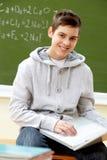 Adolescente con la computadora portátil Foto de archivo