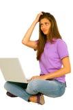 Adolescente con la computadora portátil Imágenes de archivo libres de regalías