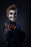 Adolescente con la demostración del cráneo del maquillaje indica Fotos de archivo
