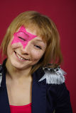 Adolescente con la estrella rosada en la cara Fotos de archivo libres de regalías