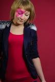 Adolescente con la estrella rosada en la cara Imágenes de archivo libres de regalías