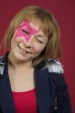 Adolescente con la estrella rosada en la cara Foto de archivo libre de regalías