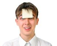 Adolescente con la etiqueta engomada en blanco Fotografía de archivo